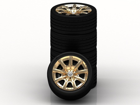 Black wheels with golden disks on white background photo