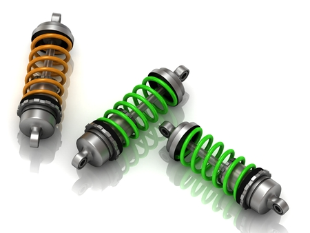 Three car shock absorbers on white background