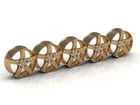 rims: Five golden disks  rims  from car are put in one row on white background Stock Photo
