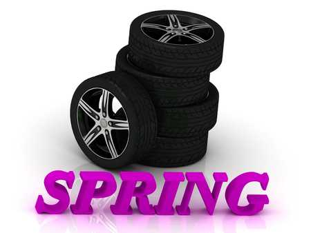 rims: SPRING- bright letters and rims mashine black wheels on a white background Stock Photo