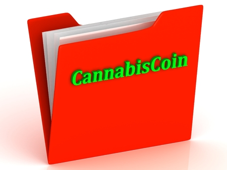 crypto: CannabisCoin- bright green letters on a gold folder on a white background Stock Photo