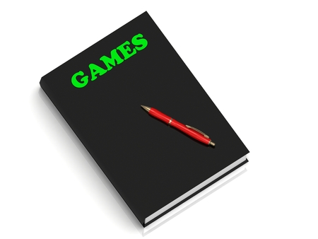 hand holding playing card: GAMES- inscription of green letters on black book on white background