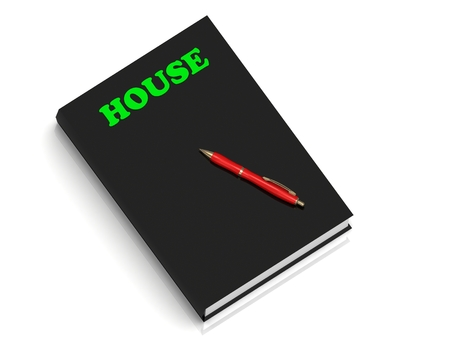 small business woman: HOUSE- inscription of green letters on black book on white background Stock Photo