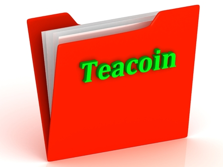 crypto: Teacoin- bright color letters on a gold folder on a white background Stock Photo