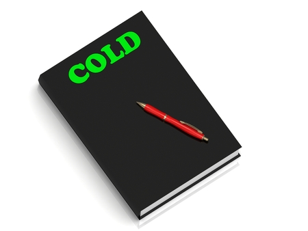 inundation: COLD- inscription of green letters on black book on white background Stock Photo