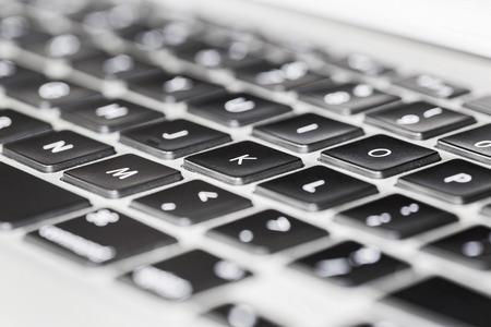 keyboard: Close up detail view of a laptop computer keyboard