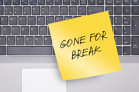 yellow paper: Gone for Break Note on Keyboard Concept Photo Stock Photo