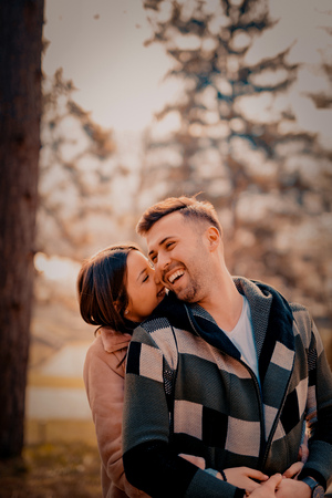 Young Beautiful Couple heaving fun outdoors at park in nature. Nice atmosphere with full of love. Standard-Bild - 116002445