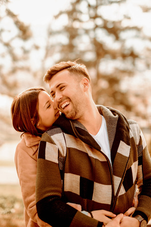 Young Beautiful Couple heaving fun outdoors at park in nature. Nice atmosphere with full of love. Standard-Bild - 116002640