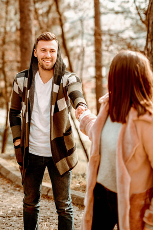 Young Beautiful Couple heaving fun outdoors at park in nature. Nice atmosphere with full of love. Standard-Bild - 116002644