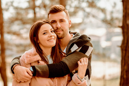 Young Beautiful Couple heaving fun outdoors at park in nature. Nice atmosphere with full of love. Standard-Bild - 116002652