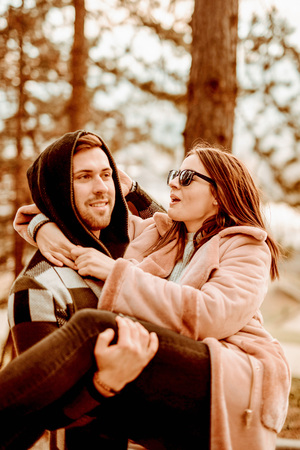 Young Beautiful Couple heaving fun outdoors at park in nature. Nice atmosphere with full of love. Standard-Bild - 116002680