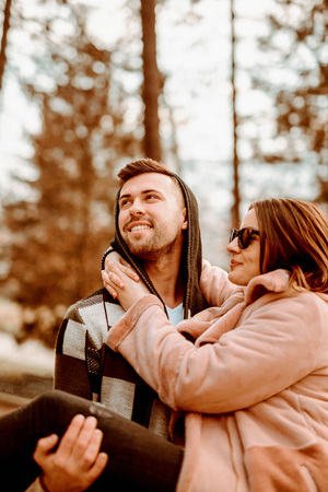 Young Beautiful Couple heaving fun outdoors at park in nature. Nice atmosphere with full of love. Standard-Bild - 116002691