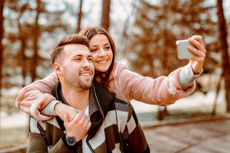 Young Beautiful Couple heaving fun outdoors at park in nature. Nice atmosphere with full of love. Standard-Bild - 116002696