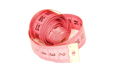 tailor measuring tape: Rolled tailor measuring tape pink isolated on white Stock Photo