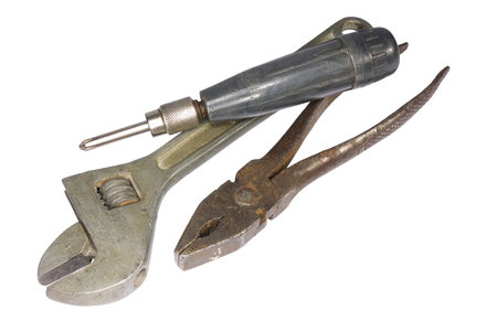 tool kit: Vintage used screwdriver, pliers, adjustable wrench tool kit isolaed on white background