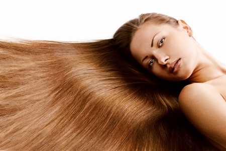 shiny hair: young beautiful girl with beautiful long brown healthy shiny hair
