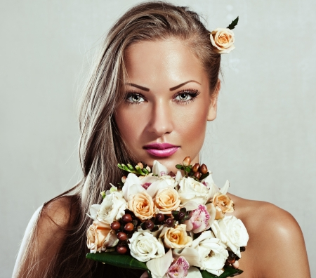 young beautiful woman with flowers , glamour makeup , make-up , perfect clean skin , long hair photo