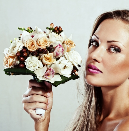 young beautiful woman with flowers , glamour makeup , make-up , perfect clean skin , long hair Stock Photo - 15590614