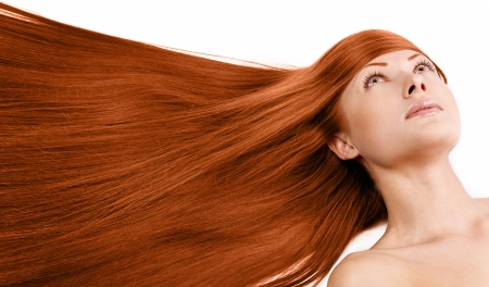 closeup portrait of a beautiful young woman with elegant long red shiny hair , hairstyle , isolated on white background , healthy straight hair Stock Photo - 15661937