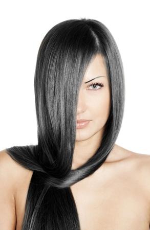 cabello negro: closeup retrato de una bella mujer joven con elegante peinado largo brillante concepto pelo, Foto de archivo
