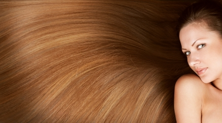 shiny hair: closeup portrait of a beautiful young woman with elegant long shiny hair , concept hairstyle
