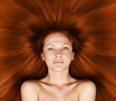 fashion concept portrait of a woman with beautiful long red healthy shiny hair Stock Photo - 15661939