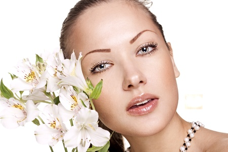 sensual young woman with perfect clean skin holding flowers Stock Photo - 15661956