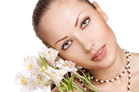 sensual young woman with perfect clean skin holding flowers Stock Photo - 15661954