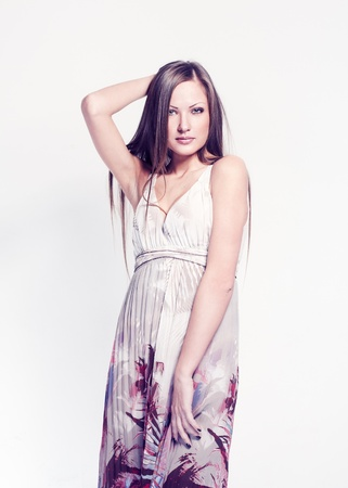young beautiful woman , with healthy long straight hair , in trendy dress , fashion model Stock Photo - 15720220