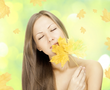 beautiful smiling woman , holding autumn leaves Stock Photo - 15720221