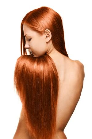 pelo rojo: closeup retrato de una bella mujer joven con elegante peinado largo brillante concepto pelo, Foto de archivo