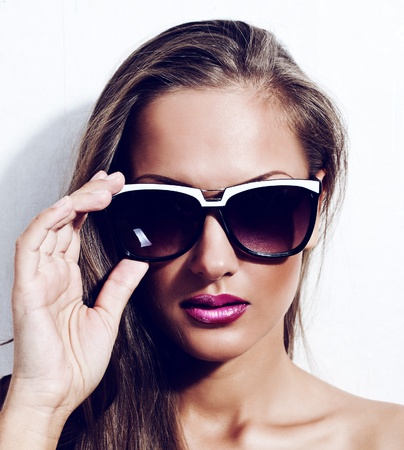 fashion model in sunglasses , beautiful young woman photo