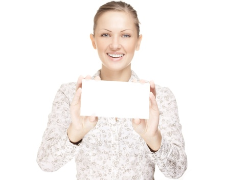 woman holding a business card and smiling Stock Photo - 15752478