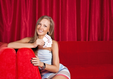 gamblers: beautiful young woman holding poker cards