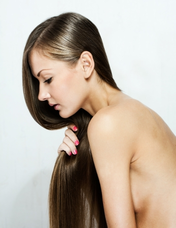 closeup portrait of a beautiful young woman with elegant long shiny hair Stock Photo - 16011584