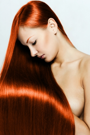 red hair , beautiful young red-headed woman with long shiny hair , hairstyle photo