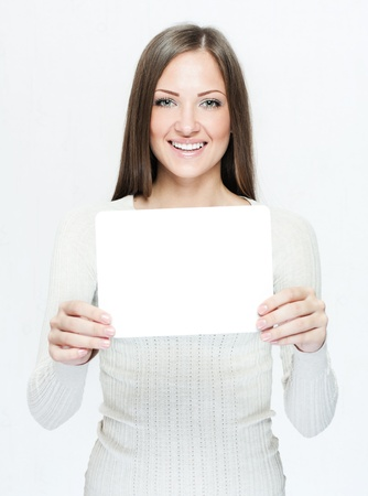 businesswoman card: young smiling woman holding blank business card
