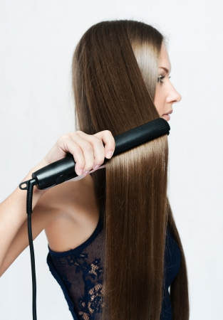 woman with long hair , makes styling hair photo
