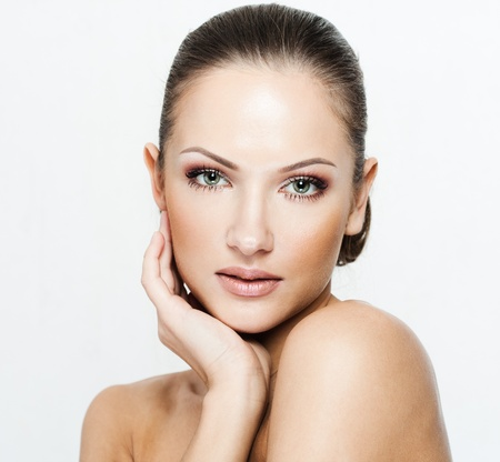 perfect face: closeup portrait of a beautiful woman with beauty face and clean face skin , glamour makeup