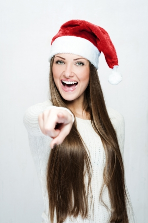 young smiling woman in santa hat photo