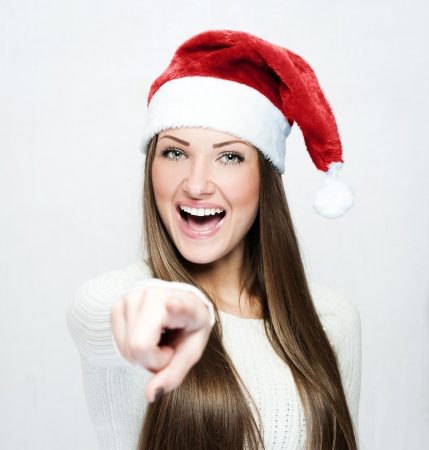 young smiling woman in santa hat Stock Photo - 16467481