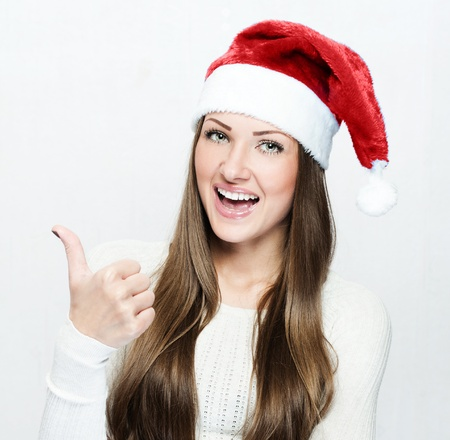 young smiling woman in santa hat Stock Photo - 16467494