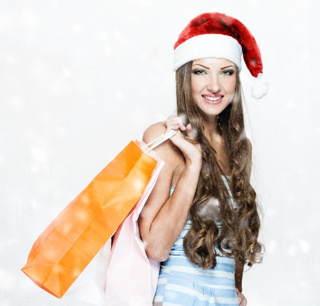 happy beautiful woman in santa hat Stock Photo - 16467467