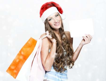 happy beautiful woman in santa hat Stock Photo - 16467491