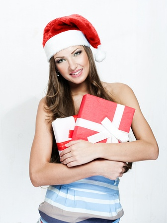 happy beautiful woman in santa hat