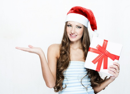 happy beautiful woman in santa hat Stock Photo - 16467512