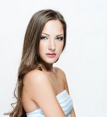 beautiful woman with long hair in dress , fashion model , glamour makeup photo