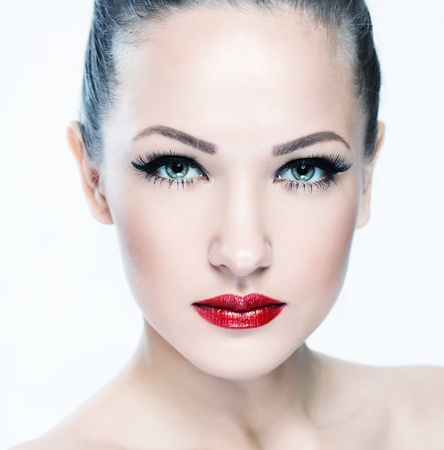 blue eyes: closeup portrait of a beautiful woman with beauty face and clean face skin , glamour makeup