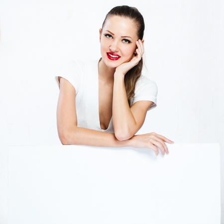 beautiful happy smiling woman hold white blank board , blank paper photo